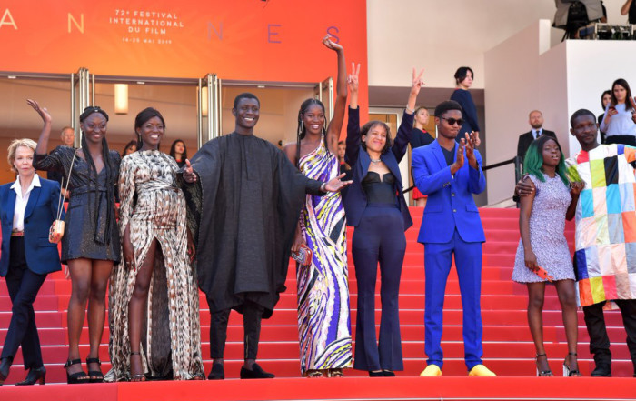 Mati Diop with cast from Atlantique at Cannes Film Festival